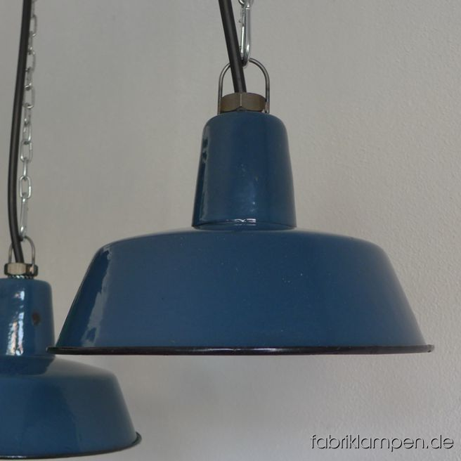 Rare old blue enamel industrial lamps. The old factory lamps have the traces of usage and age. Material: pale blue (inside white) enameled steel sheet, hallmarked. Cleaned and newly electrified, with E27 ceramic bulbholders. Height of the lamps ca. 13 cm (5,1  inches), diameter of the shades ca. 25 cm (9,8 inches).