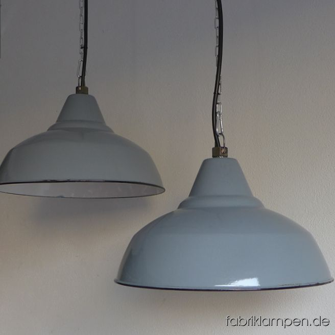Very rare antique gray industrial lamps as pair. These old factory lamps have the traces of usage and age. Material: pale gray (inside white) enameled steel sheet. Cleaned and newly electrified, with E27 ceramic bulbholders. Height of the lamps ca. 24,5 cm (9,6  inches), diameter of the shades ca. 41 cm (16,1 inches).