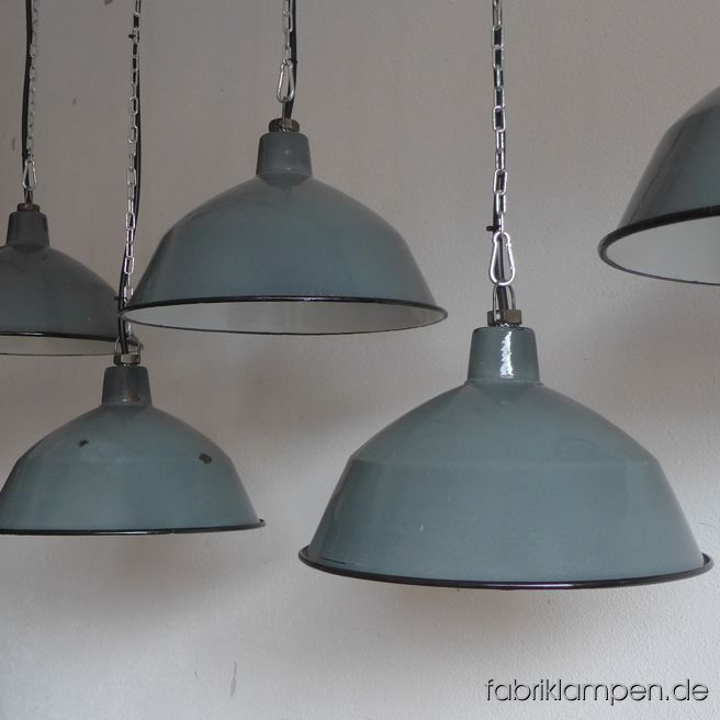 Rare antique factory lamps with nice colour (cement-gray with a touch of reseda green). These old industrial lamps have the traces of usage and age. Material: gray/greenisch gray (inside white) enameled steel sheet. Cleaned and newly electrified, with E27 ceramic bulbholders. Height of the lamps ca. 19 cm (7,5  inches), diameter of the shades ca. 35 cm (13,8 inches).