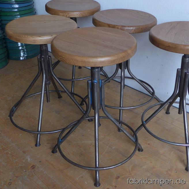 Very nice old industrial stools with oak sits. The pedestals are cleaned and conserved (here and there with remains of original colour like blue or green). These old stools became new oak sits, they are waxed. The oak massive sits are 3,8 cm (1,5 inches) thick, their diameter amount to 35 cm (13,8 inches). Everlasting, suitable for gastronomy or for your loft-kitchen.