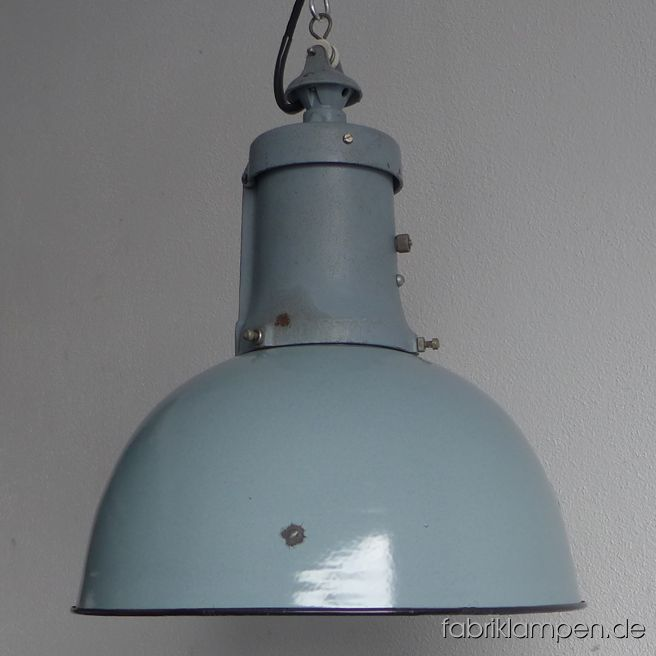 Nice old pale gray industrial lamp with enamel shade and casted iron top, also in pale gray. Material: pale gray (inside white) enameled steel sheet, casted iron head. With some traces of age and usage. Cleaned, newly electrified, with E27 ceramic socket. Height of the lamp ca. 47 cm (18,5 inches), diameter of the shades ca. 40 cm (15,7 inches). The lamp will be shipped with 2 m textile cable (in color of your choice). Chain suspension is possible for an additional charge.