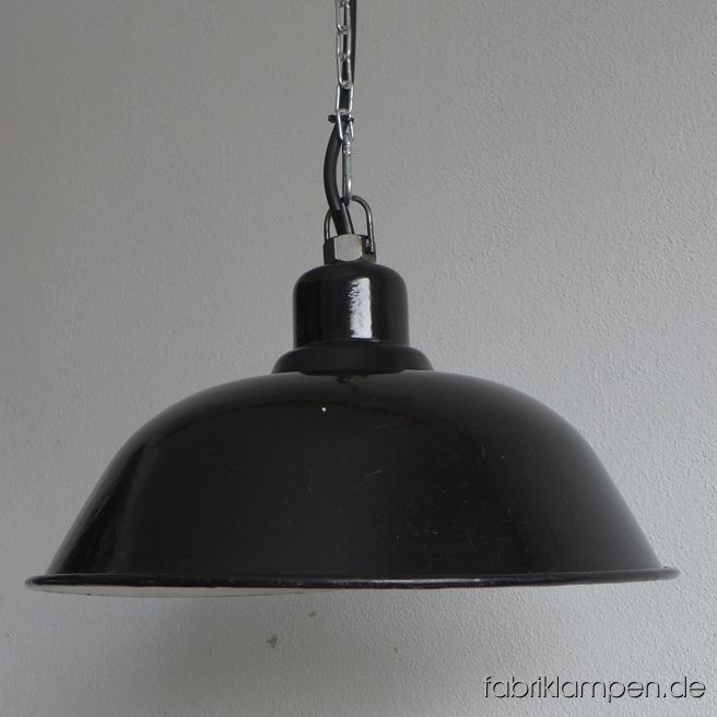 Very rare and nice old black factory lamp from the 1920ies. Material: black (inside white) enameled steel sheet. With light traces of age and usage. Cleaned, newly electrified, with E27 ceramic socket. Height of the lamp ca. 21 cm (8,3 1inches), diameter of the shade ca. 41 cm (16,1 inches). The lamp will be shipped with 2 m cable and suspension eye (chain or steel-tube suspension is possible for an additional charge).