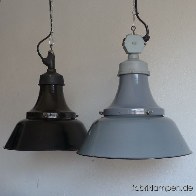 Nice old antique factory lamps with enamel shade and casted iron top. Germany, about 1930. Material: black or pale gray (inside white) enameled steel sheet, casted iron head. With some traces of age and usage. Cleaned, newly electrified, with E27 ceramic socket. Height of the lamps ca. 44 cm (17,3 inches), diameter of the shades ca. 41,5 cm (16,3 inches). The lamp will be shipped with 2 m textile cable (in color of your choice). Chain suspension is possible for an additional charge.