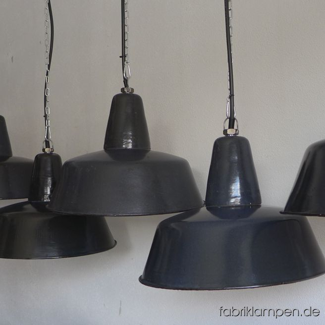 Very rare old dark blue industrial lamps, restored. Material: dark blue (inside white) enameled steel sheet. These old industrial lamps have the traces of usage and age. They are cleaned, conserved, newly electrified, with new E27 bulbholders. Height of the lamp is ca. 30 cm (11,8 inches), diameter of the shade is ca. 41 cm (16 inches).