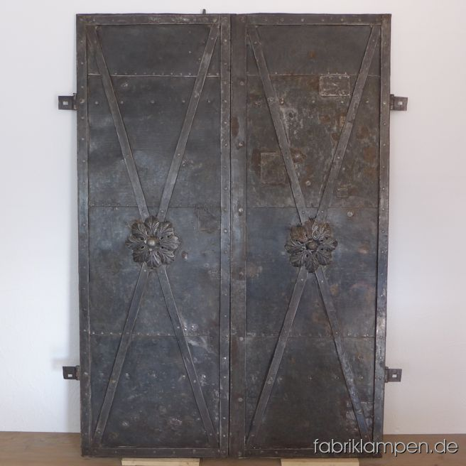 Antique wrought iron door with nice rosette and working lock. Very good condition, from about 1820. Everything original, no rust perforations. Cleaned and conserved (hard oil/wax), immediately usable. Height ca. 184 cm (72,4 inches), width ca. 134 cm (57,8 inches).