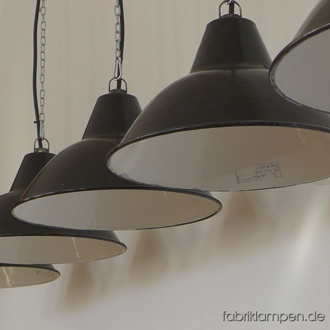 Old black enamel factory lamps, producer LBD (VEB Leuchtenbau Dresden). The lamps have moderate traces of usage and age. Material: black (inside white) enameled steel sheet. Newly electrified, with E27 ceramic sockets. Height of the lamps ca. 21 cm (8,3 inches), diameter of the shades ca. 38,5 cm (15,1 inches). We have also the bigger version of this type in stock.