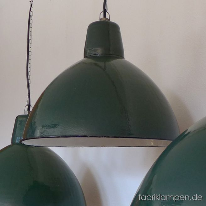 Old green enamel lamp. These lamps belong to the biggest old green enamel lamps ever. The old factory lamps have the traces of usage and age. Material: green (inside white) enameled steel sheet. Clenad and newly electrified, with E27 ceramic bulbholders. Height of the lamps ca. 43 cm (17 inches), diameter of the shades ca. 57 cm (22,4 inches).