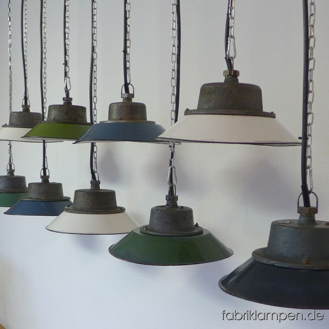 Old industrial lamps with enamel shade in various colours.Very nice and playful collection. Material: casted iron dome with green, blue and white enameled steel sheet (partly hallmarked). We have various shades of colours (green, blue) in stock. With traces of age and usage, cleaned and preserved. Newly electrified, with E27 sockets – we recommend LED bulbs for these lamps. Height of the lamps only ca. 11 cm (4,3 inches), diameter of the shades ca. 30 cm (12 inches). The lamps will be shipped with 2 m cable and suspension eye (chain suspension is possible for an additional charge).