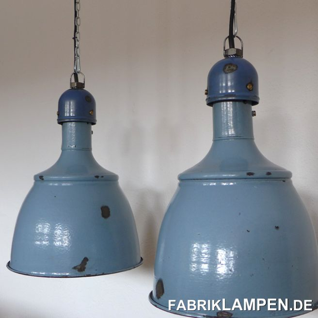 Old blue industrial lamp: very rare old pale blue enamel lamps from the 1920's. The beautiful colour is pale blue, top in blue. The lamps have strong traces of usage and age. Material: blue (inside white) enameled steel sheet. Cleaned and conserved, newly electrified, with E27 ceramic sockets. Please note: the form of these lamps is very popular and these lamps will be produced again in Eastern-Europe (and offered as originals in various colours). The cheap replicas are not difficult to identify. These lamps, as all of our lamps, are of course originals of their time.Height of the lamps ca. 42 cm (16,5 inches), diameter of the shades ca. 31 cm (12,2 inches).