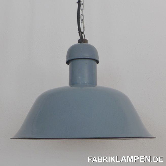 Very rare old pale blue industrial lamp, restored. Material: pale blue (ca. pastel blue, RAL 5024, with some gray), inside white enameled steel sheet. The old industrial lamp has the traces of usage and age. It is cleaned, conserved, newly electrified, with new E27 bulbholders. Height of the lamp is ca. 27 cm (10,6 inches), diameter of the shade is ca. 41 cm (16 inches). The lamp will be shipped with 2 m cable and suspension eye (chain or steel-tube suspension is possible for an additional charge).