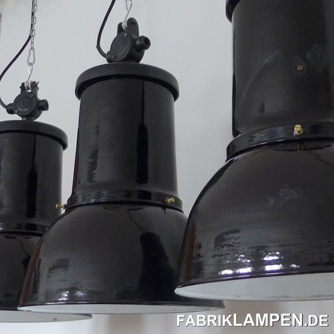 Very rare old black industrial lamp, restored. Material: black, inside white enameled steel sheet, casted iron dome and distribution box. The old industrial lamp has several traces of usage and age. It is cleaned, conserved, newly electrified, with new E27 bulbholders. Height of the lamp is ca. 58 cm (22,8 inches), diameter of the shade is ca. 36 cm (14,2 inches). The lamp will be shipped with 2 m textile cable and suspension eye (chain suspension is possible for an additional charge).