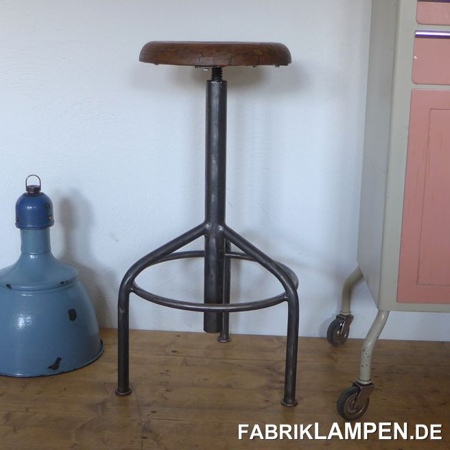 Old industrial stool with hardwood sit. Very robust and high – rare version.  The pedestal is cleaned and conserved. The hardwood sit – with traces of age and usage - is waxed.Everlasting, suitable for gastronomy or for your loft-kitchen. Sitting height between 76 and 100 cm (30 – 39,5 inches). Diameter sit 33 cm (13,4 inches).
