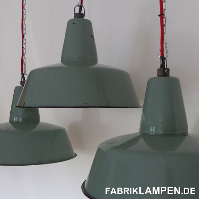 Old pastel green enamel lamps: very rare shade of green. The lamps have some traces of usage and age. Material: pasetel green (inside white) enameled steel sheet. Cleaned and conserved, newly electrified, with E27 ceramic sockets. Height of the lamps ca. 30 cm (11,8 inches), diameter of the shades ca. 41 cm (16,1 inches).