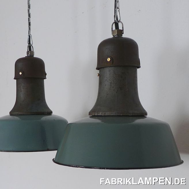 Old factory lamp, casted iron, green and blue enamel. Classic three-part design, with cast iron top, rather rare in these colors.These old lamps have some traces of usage and age. Material: green (inside white) enameled steel sheet, casted iron. We have these lamps in shades of green (more pastel green and pale green) and in blue.Restored: cleaned and conserved. Newly electrified, with E27 ceramic sockets. Height of the lamps ca. 38 cm (15 inches), diameter of the shades ca. 41 cm (16 inches). Weight: 6 kg. These old factory lamps will be shipped with 2 m cable and suspension eye (textile cable, chain or steel tube suspension is possible for an additional charge).