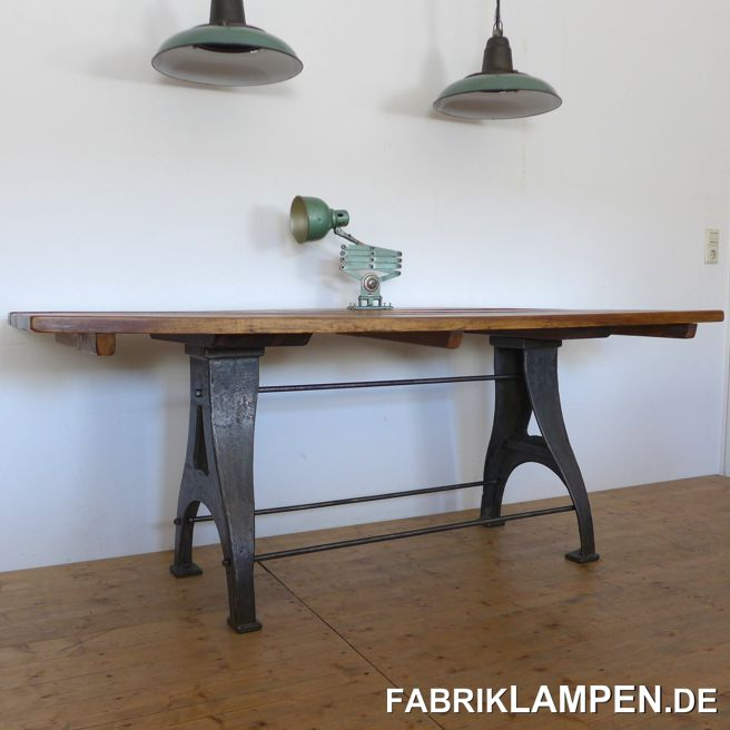 Old restored industrial table, workbench (workshop table). The table is very robust, its weight is just over 100 kg.The robust table top (solid robinia) consists of individual beams, which are connected to each other at the bottom with three crossbars. The plate hangs a bit (on the pictures on the front).After careful cleaning, the wood was sanded and sealed with beeswax. The work surface has a wonderful patina (small scratches, discoloration). There are some inactive woodworm holes in the wood (below). We have removed the wood worms ecologically (without chemicals), I am happy to write the method on request.The cast iron feet are also cleaned and conserved (again with a very nice and incomparable patina of the old metal) and sealed with a hard oil and wax mixture, so the surface remains natural. The three connections and their screws are original, which is rarely the case.Use: because of the size, the old table is versatile, both as a dining table or in retail etc.The dimensions:Height: 76 cmTable top: 199 x 70 x 4 cm (length x depth x thickness)Weight: over 100 kg.