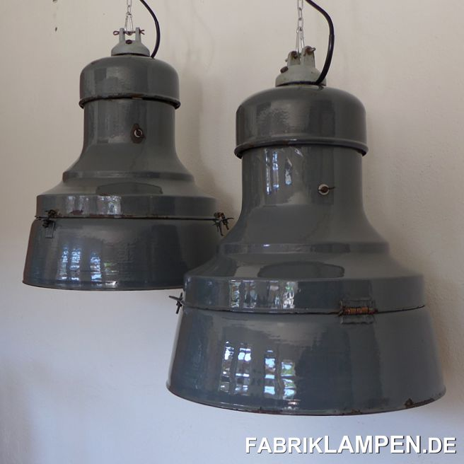Antique industrial lamps from the 1930s. Very massive design, very rare in this size. Classic three-part design, in this form they belong to the largest lamps.These rare industrial lamps have the traces of the past many decades (small dents, flaking, rust spots, scratches, discoloration and Co.). One lamp is well preserved, the other has massive signs of wear both inside and out (it probably fell). They are cleaned, preserved and newly electrified, with E40 / E27 ceramic socket (adapter). Material: grayish-blue, inside white enameled sheet steel, brass, cast iron.The dimensions: height of the lamp about 62 cm (20,4 inches), diameter about 50 cm (19,7 inches). The weight is 10 kg.The industrial lamps are supplied with 2 meters of textile cable in the color of your choice (other lengths are of course possible), on request it can also be equipped with a chain suspension (for an additional charge).