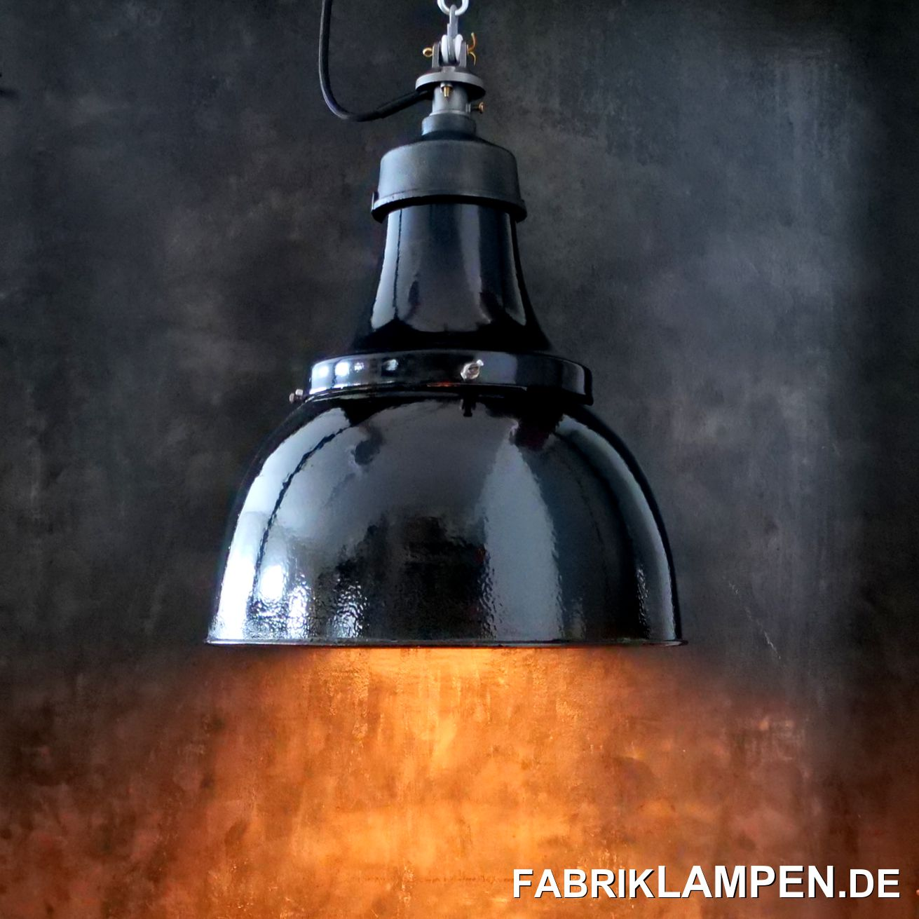 Old black industrial lamp, factory lamp with cast iron top from the 1930s. Provenance: BMW factory in Munich. The lamps were of German manufacture and hung in an old factory building in Munich until it was demolished. They were neatly soiled, but under the layer of dust the shades were in the best condition.  These lamps were usually used in harsh conditions and have massive signs of use, this lot is unusually beautifully preserved.The industrial lamps have very minor signs of use from the past decades (chips, rust spots, scratches, discolouration and co.), primarily at the bottom of the screws. The old factory lamps have been restored: cleaned, conserved and newly electrified, with new E27 ceramic sockets.Material: black (inside white) enameled steel sheet, cast iron top, cast steel suspension.Your old industrial lamp comes with 2 metres of textile cable colour of your choice (other lengths are of course possible) and solid suspension eye for safe hanging. For an extra charge, the industrial lamps can also be supplied with chain or tubular steel suspension. We can also offer canopies.Old industrial lamp, the dimensions: Height of the lamps approx. 40 cm (46 cm with suspension), diameter lamp (shade) approx. 37 cm, weight approx. 3 kg.